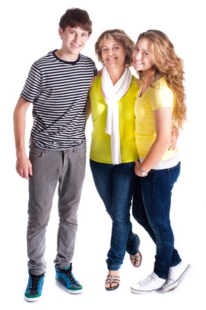 Family isolated on white background, posing indoors.. photo