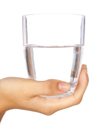 Hand holding a glass of water isolated against white background. Foto de archivo