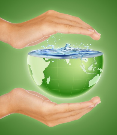 Hands around half earth globe. Nature, environment and saving the earth concept photo