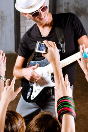 People dancing on the tune of rockstar during a concert.... Stock Photo - 10473829