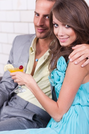 Amorous couple sharing fun moments together at restaurant. photo