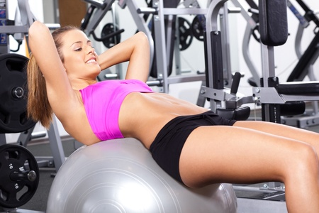 Young fit woman posing during pilate session in the gym. photo