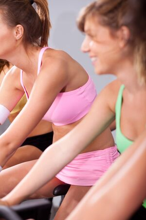 keeping fit: Group of people in a gym, cycling and keeping fit.