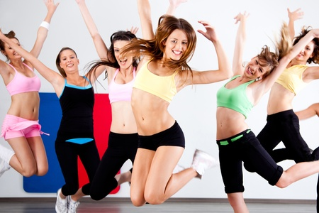 group fitness: Enthusiastic group of women having fun during aerobics class. Stock Photo