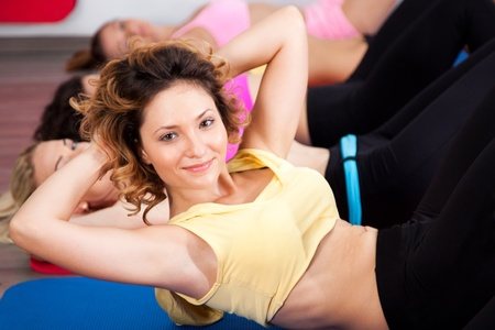 Group of gym people in an aerobics class, working out.