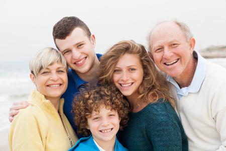 Happy family casually posing to camera photo