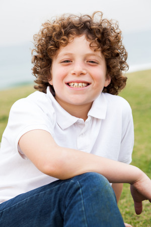 ��beautiful boy�: Young beautiful boy sitting in lawn