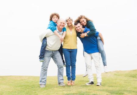 Beautiful family enjoying their summer holidays at park photo