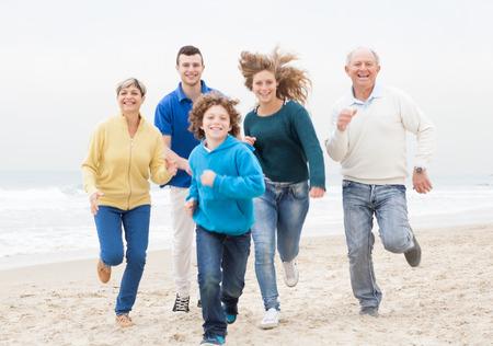 Happy family enjoying beach holiday photo