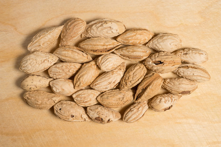 Inshell almonds for further preparation Stock Photo