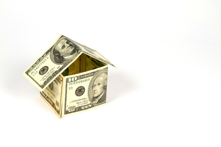 House made by money in white background photo