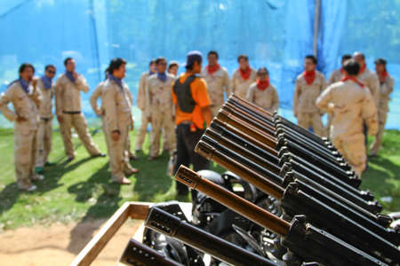 paintball: Paintball gun in a row and team player Stock Photo