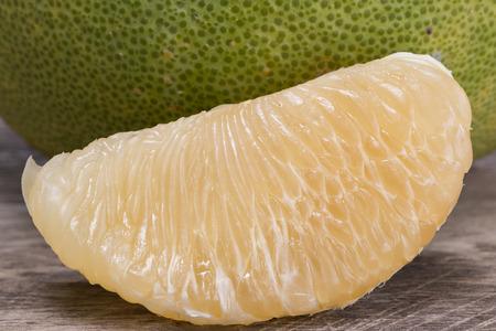 pomelo: fresh pomelo on wood floor Stock Photo