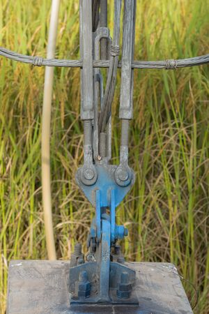 to partake: Slings lock safty with pole steel on stake in rice field