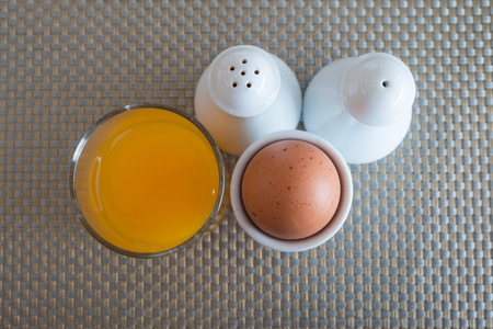 egg cups: Boiled eggs in egg cups with orange juice salt and pepper.