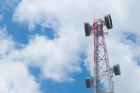 Communication Tower with antenna and satellite dish telecom network on blue sky background. Stock Photo