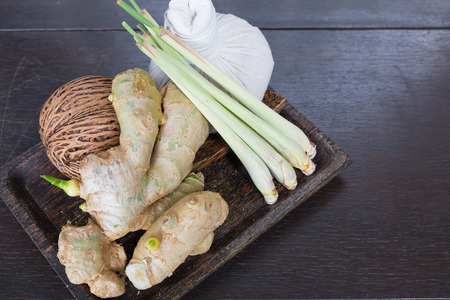 Galangal lemon grassand pack compress in wood plate use for thai massage relaxed