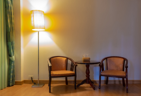 interior classic style with wood armchairs center table and lamps