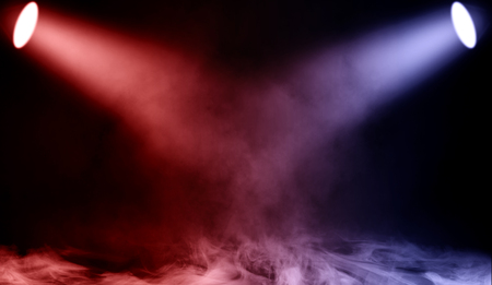 Colorful projector. Spotlight stage with smoke on the floor . Isolated background texture.