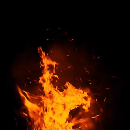 Texture of burn fire with particles embers. Flames on isolated black background. Archivio Fotografico