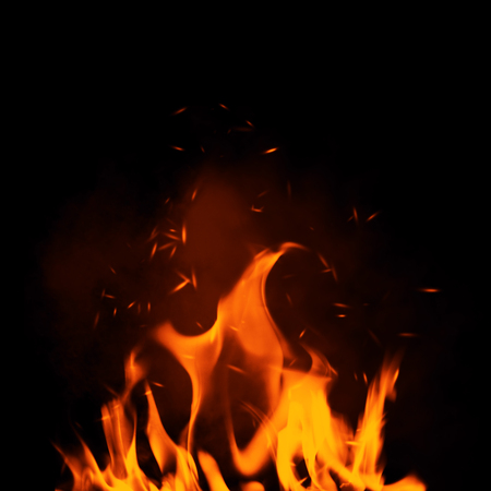 Texture of burn fire with particles embers. Flames on isolated black background. Stock fotó