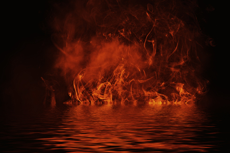 Texture of fire with reflection in water. Flames on isolated black background. Texture for banner,flyer,card .
