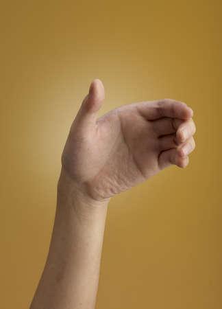 interdigital: Female hand  isolated on brown background