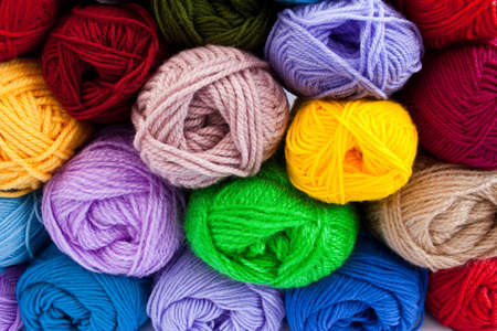 knit stitch: image of colorful different thread balls Stock Photo