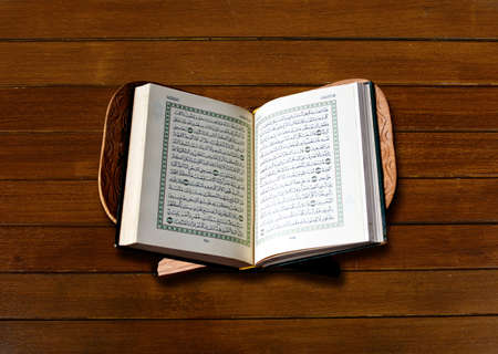 The Holy Quran  on wood background photo