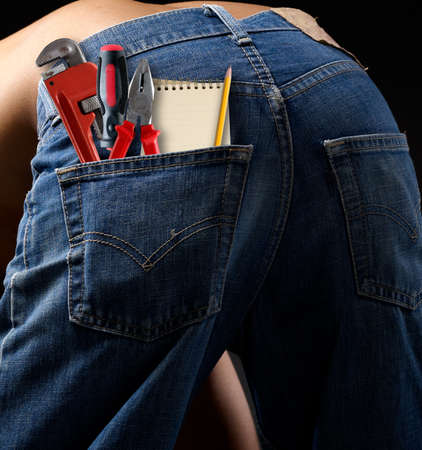 Toolkit  in a blue jeans pocket  photo