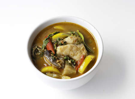 asian redtail catfish: Thai style food Red curry cook with Asian Redtail Catfish and herb