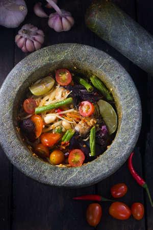 green papaya salad: Famous Thai food  spicy papaya salad with salted crab and fermented fish : somtum Stock Photo