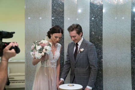 The bride and groom in the registry office