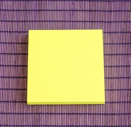 yellow note on purple background photo