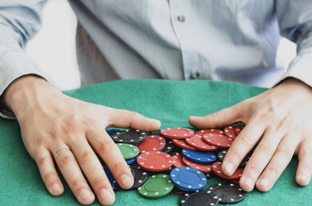 hands holding poker chips photo