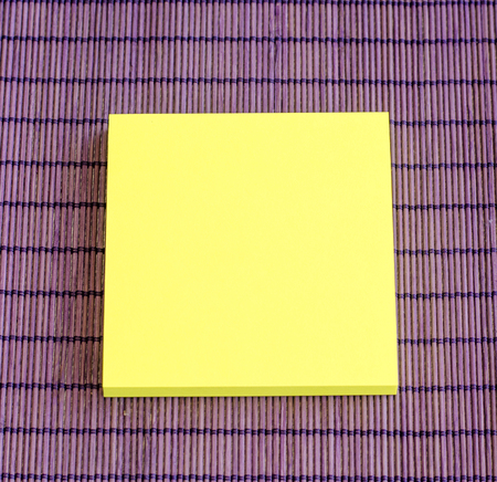 yellow note on purple background photo