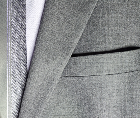 close up: detail of a grey man suit with tie