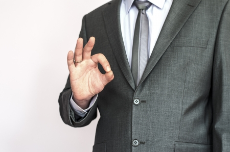 business man doing ok sign photo