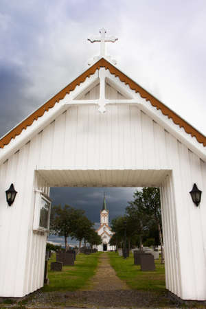 Church near lake and fjords in Norway Stock Photo