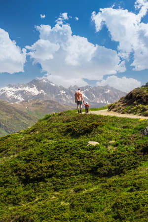 Father with his son hiking in Swiss Alps, Rinerhorn mountain, Davos, Grisons, Switzerland Stock Photo - 30138126