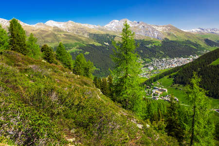 View to Davos city and Swiss Alps from the top of the Rinerhorn mountain, Grison, Switzerland photo