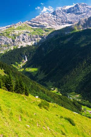 Waterfall  with mountains near Klausen Pass mountain road in Switzerland Stock Photo
