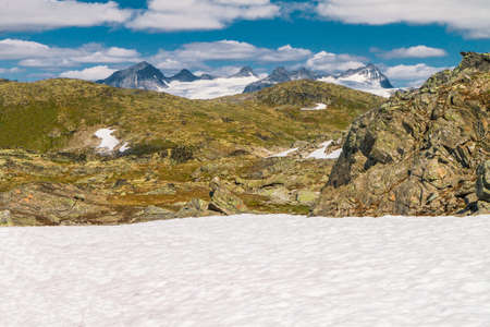 Tundra landscape with snow field near the Sognefjellsvegen - the highest mountain pass road in Northern Europe Stock Photo