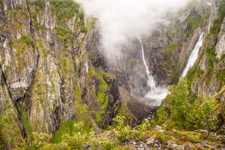 Beautiful view to valley with 182 m High Waterfall Voringfossen, Hardangervidda  Norway photo