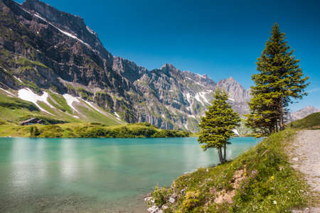 Alps valley with Truebsee lake under Titlis in Swiss Alps, Engelberg, Central Switzerland