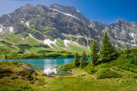 Alps valley with Truebsee lake under Titlis in Swiss Alps, Engelberg, Central Switzerland photo