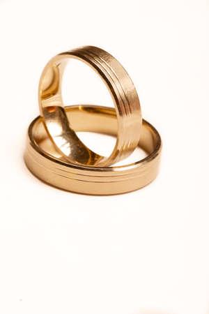Wedding rings isolated on the white background photo