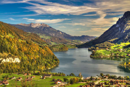 Lake Lungern Valley from Branig Pass in beautiful autumn weather, Obwalden, Switzerland, HDR Stock Photo