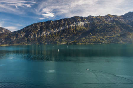 Lake Brienz surrounded by Swiss Alps in autumn beautiful weather, Bernese Highlands, Switzerland, HDR Stock Photo