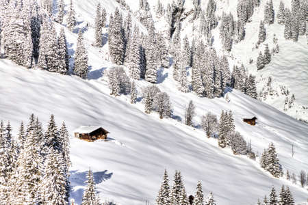 skying: Swiss Wooden Cottages in deep snow, Adelboden, Switzerland Stock Photo